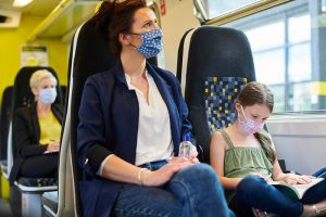 People with masks on a train