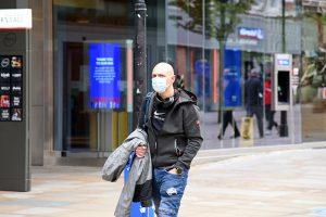 Man with mask walking